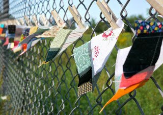Quilt Squares on a Chain Link Fence in August